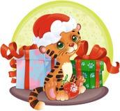 Aanbiddelijke tijger-Welp met de giften van Kerstmis Stock Foto