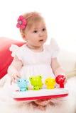 Aandachtig babymeisje die weg kijken Royalty-vrije Stock Afbeeldingen