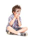 Aandachtig weinig jongen met bizar stock afbeeldingen