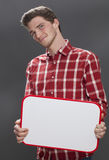 Aankondiging van het exemplaar de ruimtepaneel voor de glimlachende jonge mens Stock Fotografie