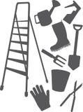 Aanpassingen en hulpmiddelen voor het werk in een tuin en een auto Stock Afbeeldingen