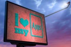 Aanplakbord met een bericht I liefde mijn apps Stock Afbeelding