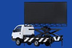 Aanplakbord op auto LEIDEN paneel die voor die teken adverteren op donkerblauwe achtergrond wordt geïsoleerd Stock Afbeeldingen