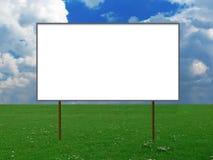 Aanplakbord op een weide stock afbeelding