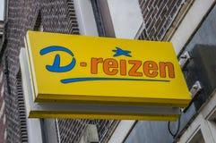 Aanplakbord van D-Reizen bij Weesp-Nederland stock afbeelding