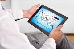 Aanrakingsstootkussen met crisisgrafiek Stock Foto