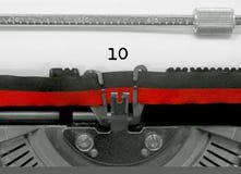 10 aantal door de oude schrijfmachine op Witboek Stock Fotografie