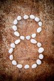 '8' aantalalfabet gemaakte vorm witte steen Stock Foto's