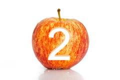 Aantalgat in appel op witte achtergrond wordt geïsoleerd die stock foto's