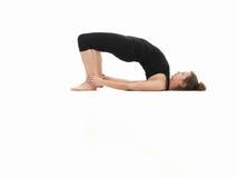 Aantonende de yogahouding van de vrouw stock afbeelding