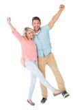 Aantrekkelijk en paar die glimlachen toejuichen Stock Foto