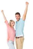Aantrekkelijk en paar die glimlachen toejuichen Stock Foto's