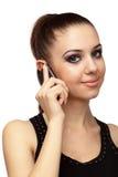 Aantrekkelijk meisje dat op een mobiele telefoon spreekt Royalty-vrije Stock Afbeeldingen