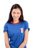 Aantrekkelijk meisje met de vlag van Frankrijk op haar blauwe t-shirt Royalty-vrije Stock Foto's