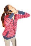 Aantrekkelijk meisje met hoofdtelefoons stock foto's