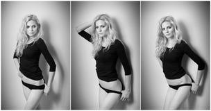 Aantrekkelijk sexy blonde in zwarte strakke geschikte blouse en bikini die provocatively stellen Portret van sensuele vrouw in kl Royalty-vrije Stock Fotografie