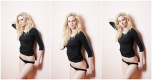 Aantrekkelijk sexy blonde in zwarte strakke geschikte blouse en bikini die provocatively stellen Portret van sensuele vrouw in kl Stock Foto