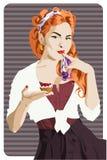 Aantrekkelijk speld-omhooggaand stijlmeisje die een cake houden royalty-vrije illustratie