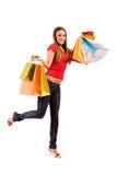 Aantrekkelijk winkelend meisje met kleurrijke zakken Stock Afbeelding