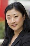 Aantrekkelijke Aziatische bedrijfsvrouw stock foto