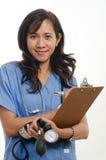 Aantrekkelijke Aziatische Filipijnse verpleegster arts Stock Foto's