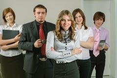 Aantrekkelijke bedrijfsdame en haar team Royalty-vrije Stock Fotografie