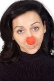Aantrekkelijke dame met een rode neus stock afbeelding