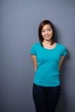 Aantrekkelijke ingetogen jonge Aziatische vrouw stock foto's