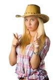 Aantrekkelijke jonge vrouw in cowboykleding en hoed royalty-vrije stock afbeelding