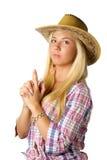 Aantrekkelijke jonge vrouw in cowboykleding en hoed stock afbeelding
