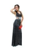 Aantrekkelijke jonge vrouw in elegante zwarte kleding Royalty-vrije Stock Afbeelding