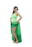 Aantrekkelijke jonge vrouw in groene kleding Stock Fotografie
