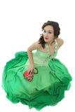 Aantrekkelijke jonge vrouw in groene kleding Royalty-vrije Stock Afbeeldingen