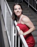 Aantrekkelijke jonge vrouw in rood Stock Foto's