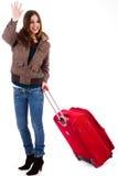 Aantrekkelijke jonge vrouwen die met koffer reizen Stock Foto's