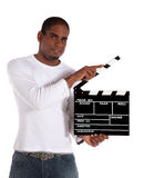 Aantrekkelijke mens die clapperboard gebruikt Royalty-vrije Stock Foto's