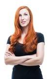 Aantrekkelijke nadenkende roodharigevrouw Stock Foto