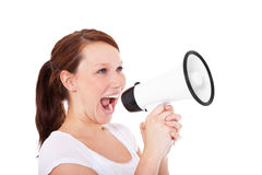 Aantrekkelijke vrouw die megafoon met behulp van Royalty-vrije Stock Foto's