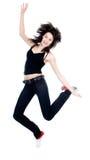 Aantrekkelijke vrouw die op witte achtergrond springt Royalty-vrije Stock Foto's