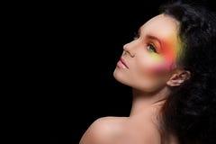 Aantrekkelijke vrouw met gekleurde samenstelling stock afbeelding