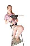 Aantrekkelijke vrouw met puncher op ladder royalty-vrije stock fotografie