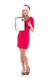 Aantrekkelijke vrouw in santahoed met de duimen omhoog geïsoleerde van de wenslijst Royalty-vrije Stock Afbeelding