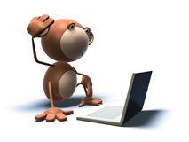 Aap met laptop Royalty-vrije Stock Afbeeldingen