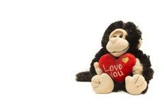 Aap plucheachtig stuk speelgoed met I-het teken van Liefdeu op wit Royalty-vrije Stock Afbeelding