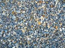 Aardachtergrond van grijze multicolored overzeese kiezelstenen Stock Afbeelding