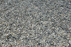 Aardachtergrond van grijze overzeese kiezelstenen, kiezelsteen voor tuindecor Stock Afbeelding