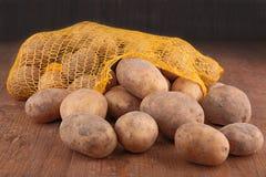 Aardappel in zak Stock Foto's