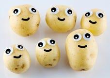 Aardappelmensen met ogen en glimlachen Royalty-vrije Stock Foto's