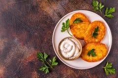 Aardappelpannekoeken, knoeiboel braun royalty-vrije stock foto