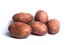 Aardappels die op een witte achtergrond worden geïsoleerdd Royalty-vrije Stock Foto's